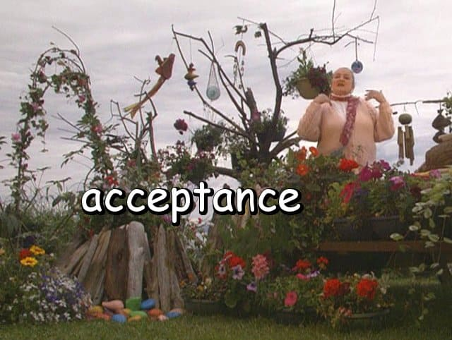 "the word ""acceptance"" with Marie in her beach garden"